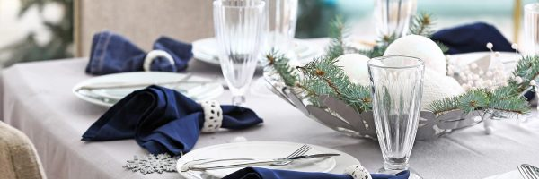 Festive table setting for Christmas dinner at home